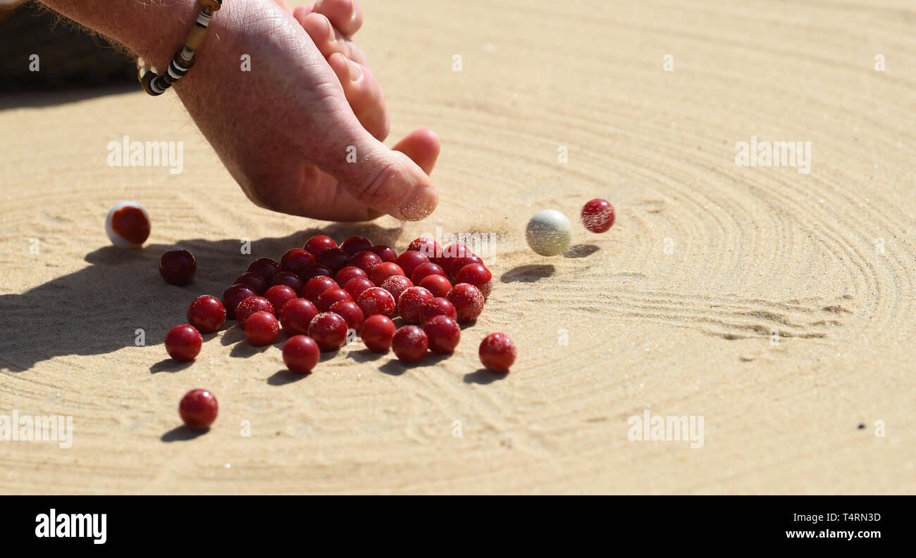 Crawley Sussex, UK. 19th Apr, 2019. Action from the World Marbles Championship held at The Greyhound pub at Tinsley Green near Crawley in Sussex . The annual event has been held on Good Friday every year since the 1930s and is open to players from around the world Credit: Simon Dack/Alamy Live News Stock Photo
