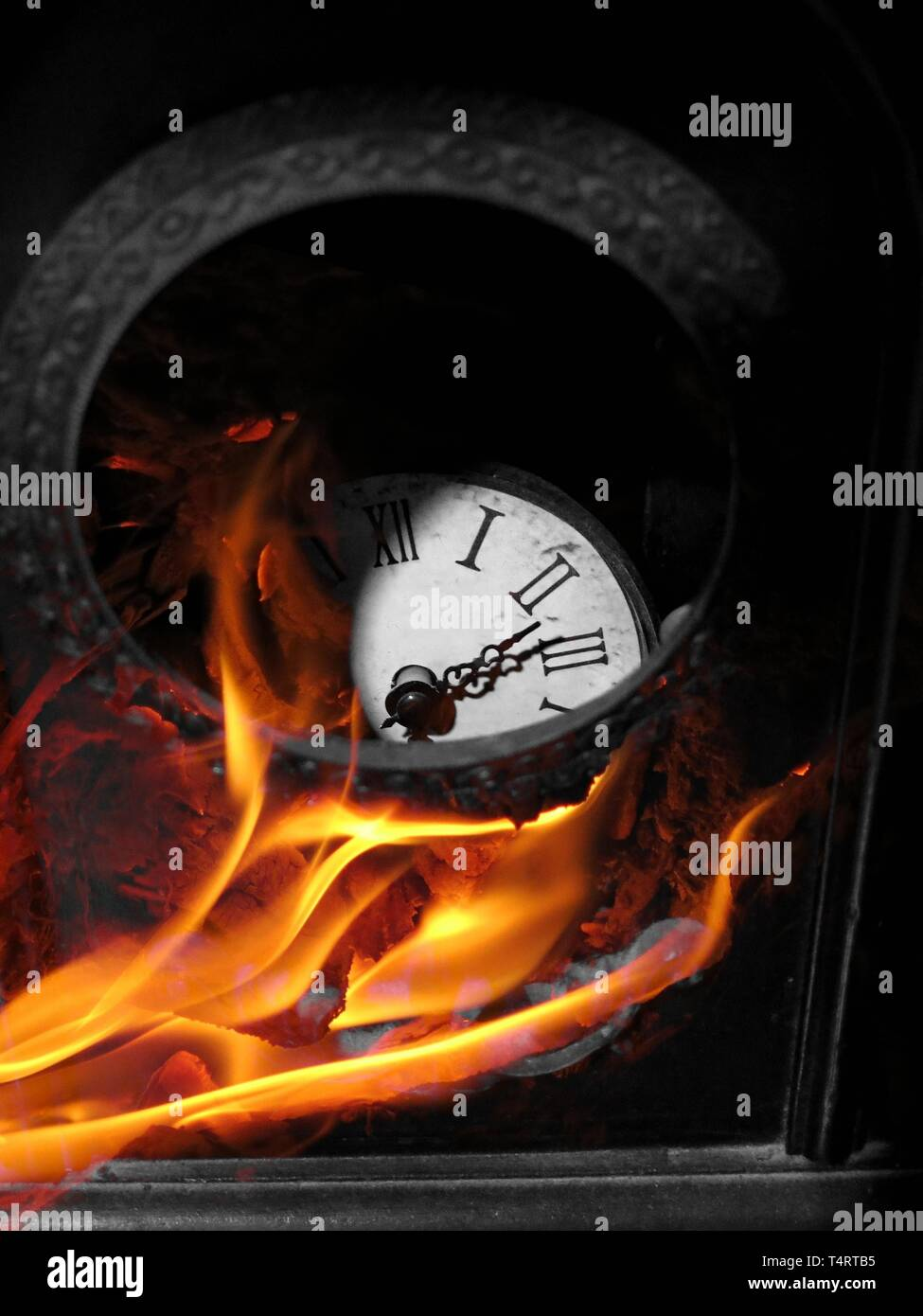 Antique clock on fire. - Stock Image