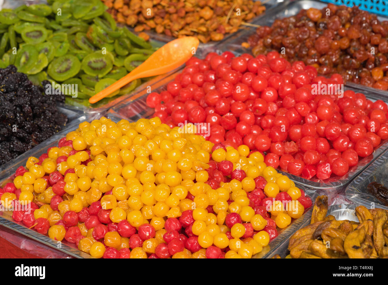 Colorful dried salted or sugared Asian tropical fruits Stock Photo