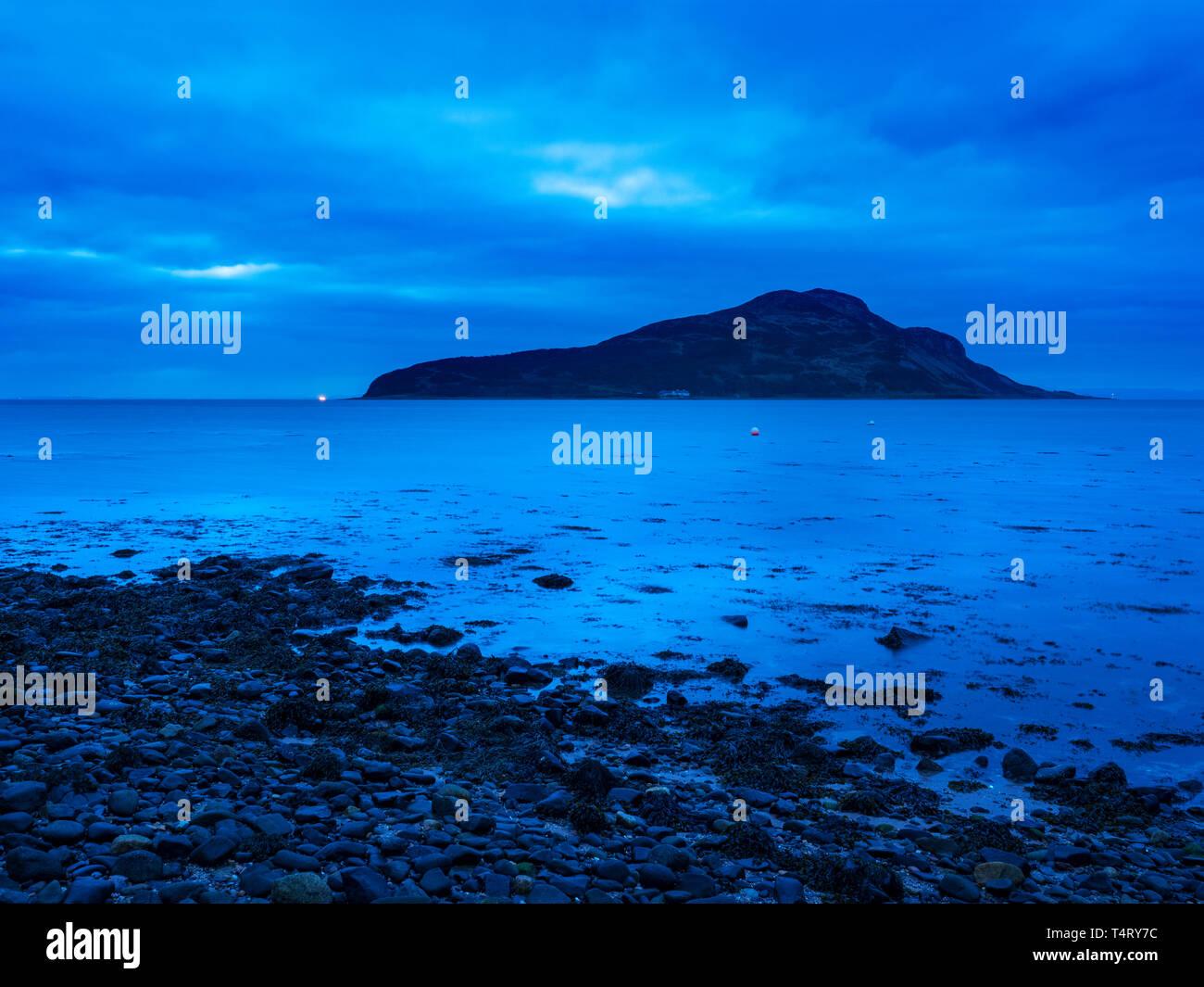 Holy Isle at dawn from Lamlash on the Isle of Arran North Ayrshire Scotland - Stock Image