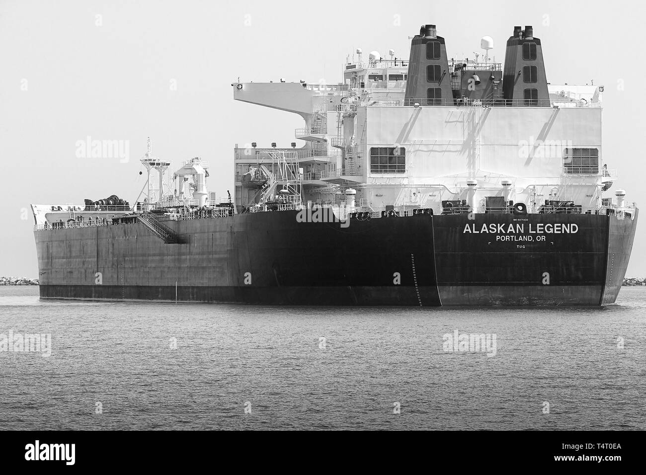 Black And White Photo Of The Giant Supertanker (Crude Oil Tanker), ALASKAN LEGEND, Anchored In The Port Of Long Beach, California, USA. - Stock Image
