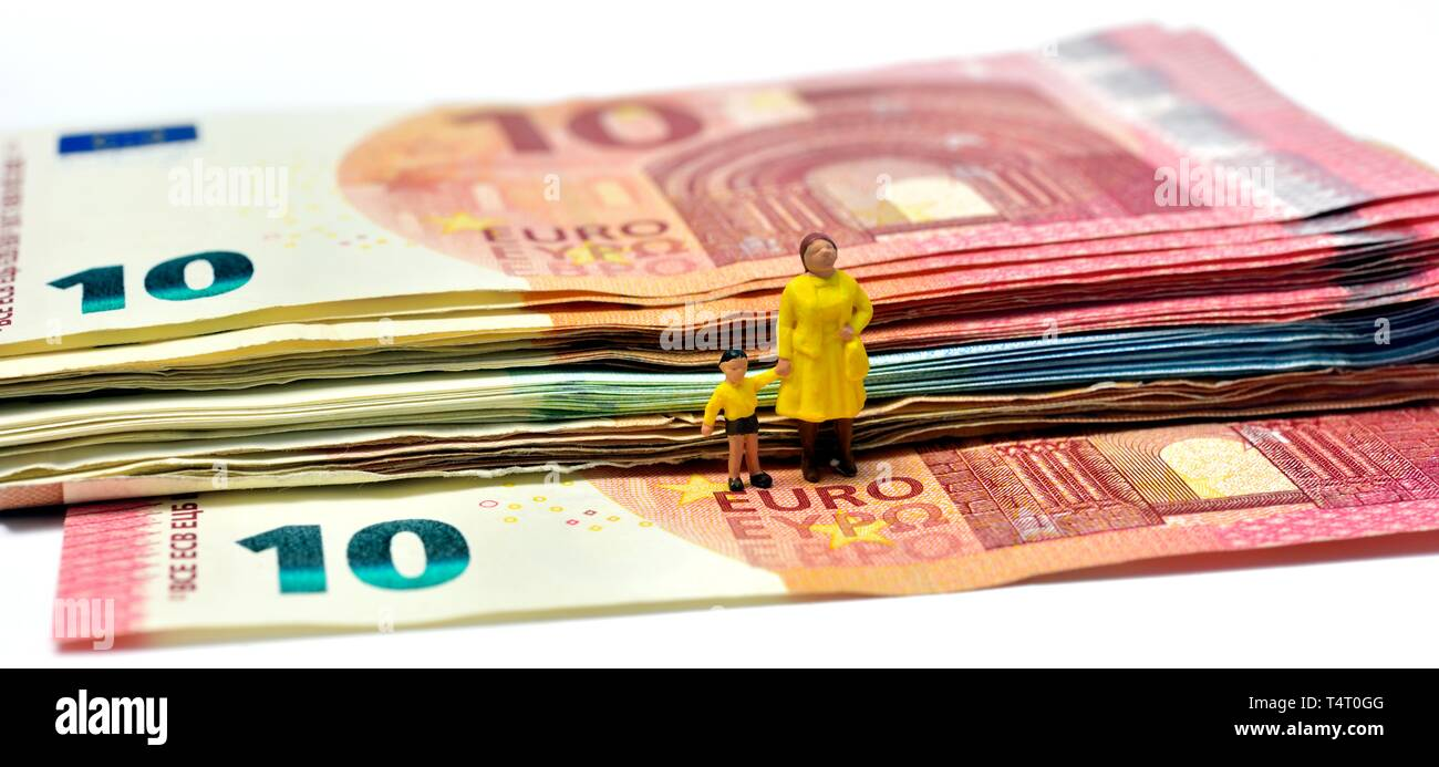 Miniature figurines,single parent with child, on euro notes,currency, - Stock Image