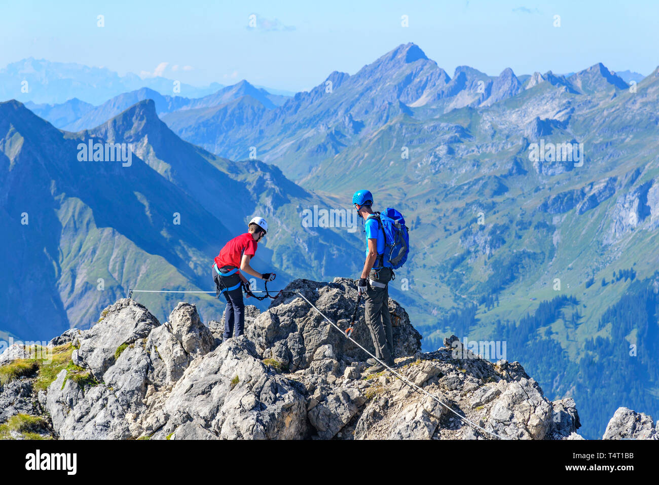 Impressive climbing on safeguarded via ferrata in western austria - Stock Image