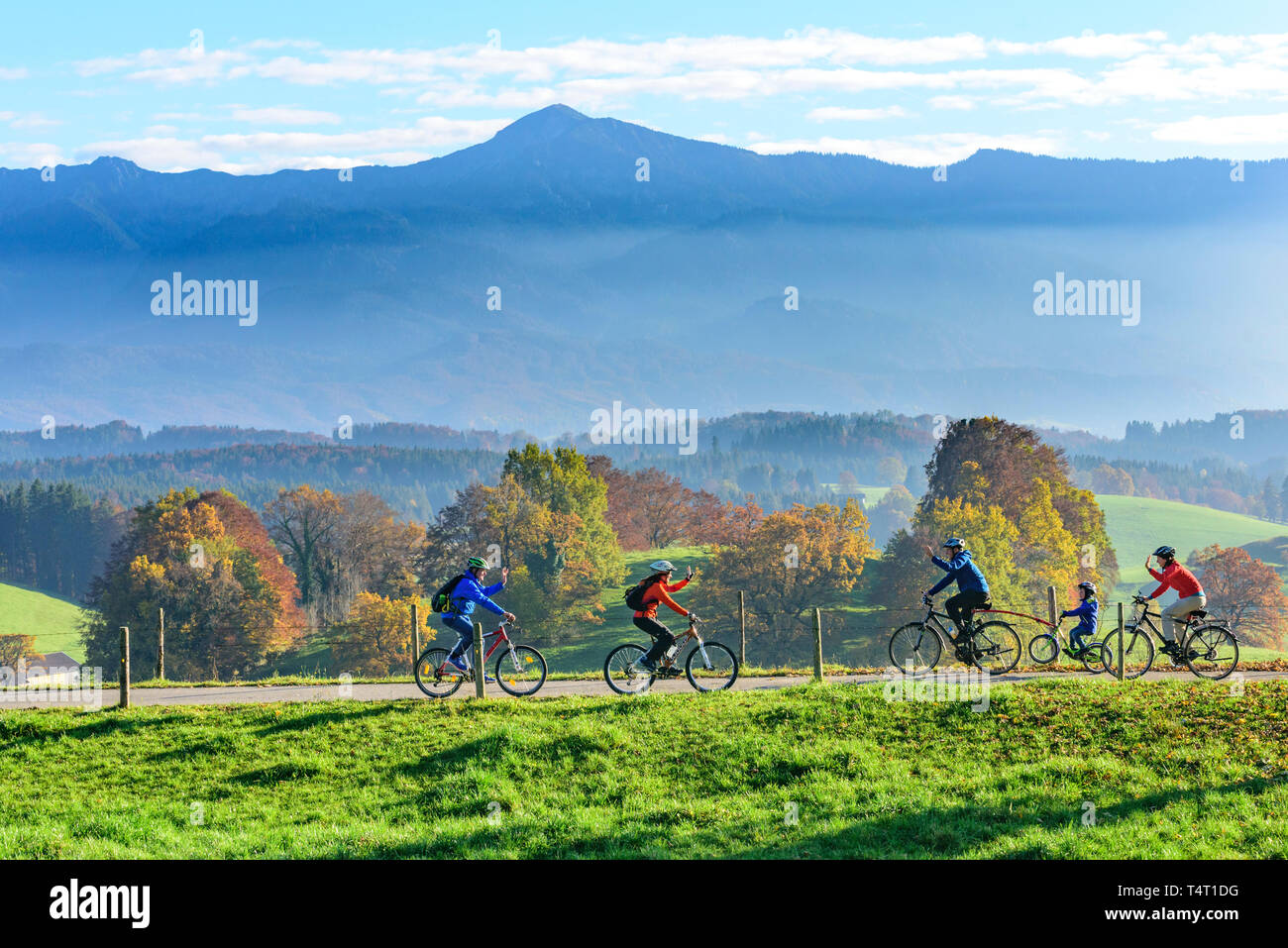 Cyclists meet on a small road in Upper Bavaria - Stock Image