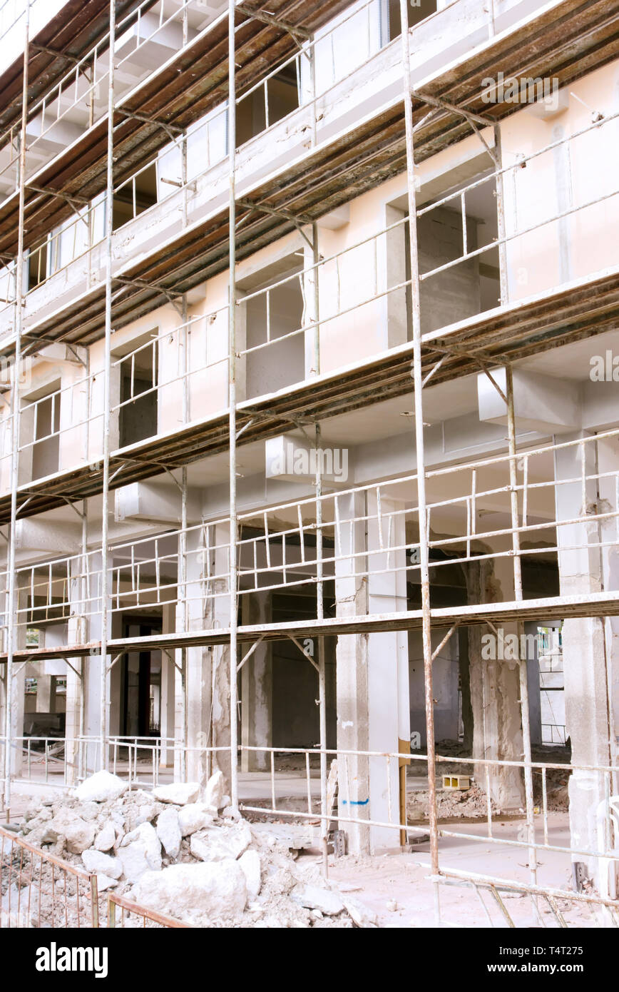 Building renovation. Scaffolding around building. Close up - Stock Image