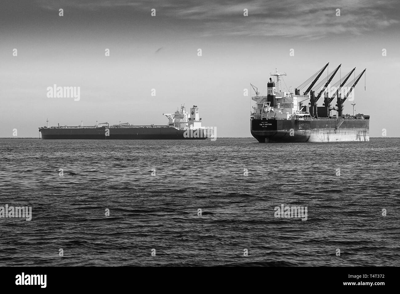 Black And White Photo Of The Bulk Carrier, YM Tradition And The Supertanker, Eagle Varna, Anchored In The Port Long Beach, California. USA. - Stock Image