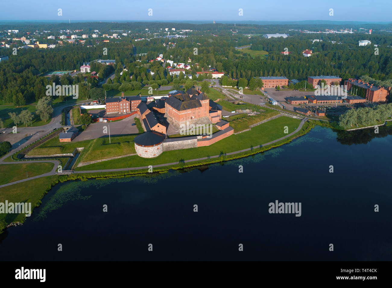The ancient  Hameenlinna fortress  on the shore of Vanajavesi lake on a July morning (aerial photography). Finland Stock Photo