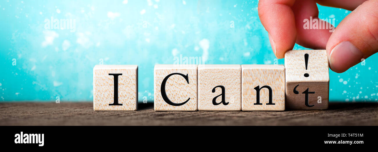 Hand Changing Word On Wooden Cube From I Can't To I Can With Abstract Blue Background - Positiveness Concept - Stock Image