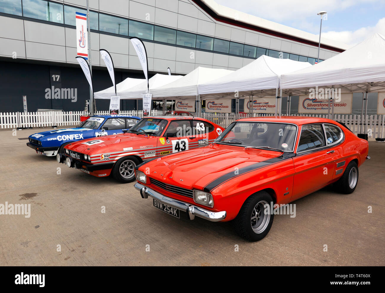 Ford Capri's on display in the International Paddock, part of the 50th Anniversary Celebrations  at the 2019 Silverstone Classic Media Day - Stock Image