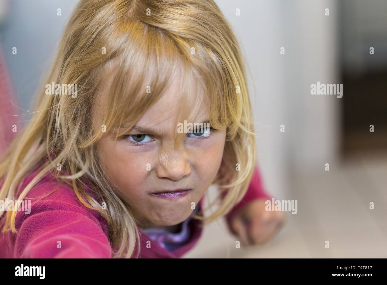 Girl (6) looks grim - Stock Image