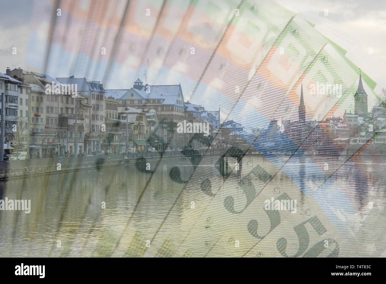 Zurich with the river and Swiss franc banknotes, Symbol photo - Stock Image