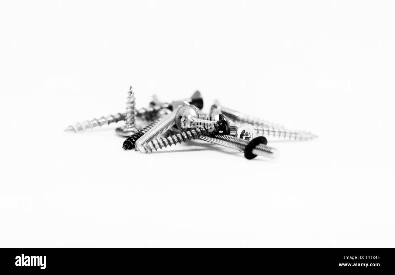 several screws in black and white - Stock Image