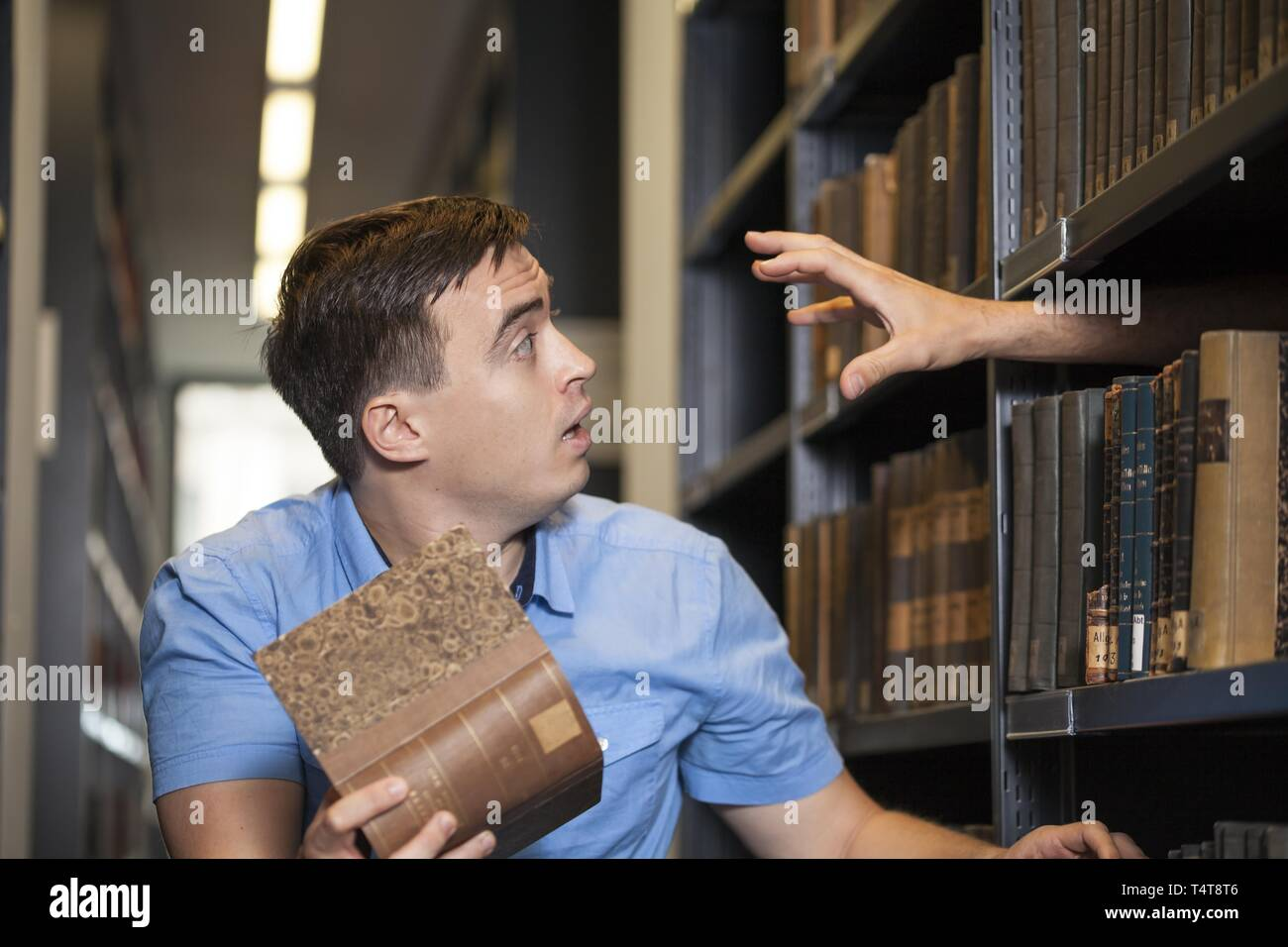 Student will be frightened in a library - Stock Image