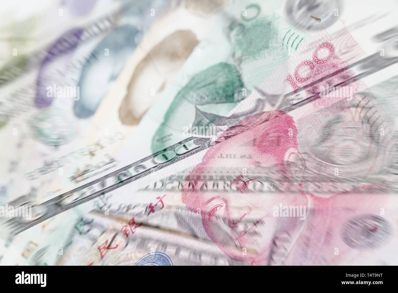 Chinese Yuan and US Dollar notes, blurred, symbol photo - Stock Image