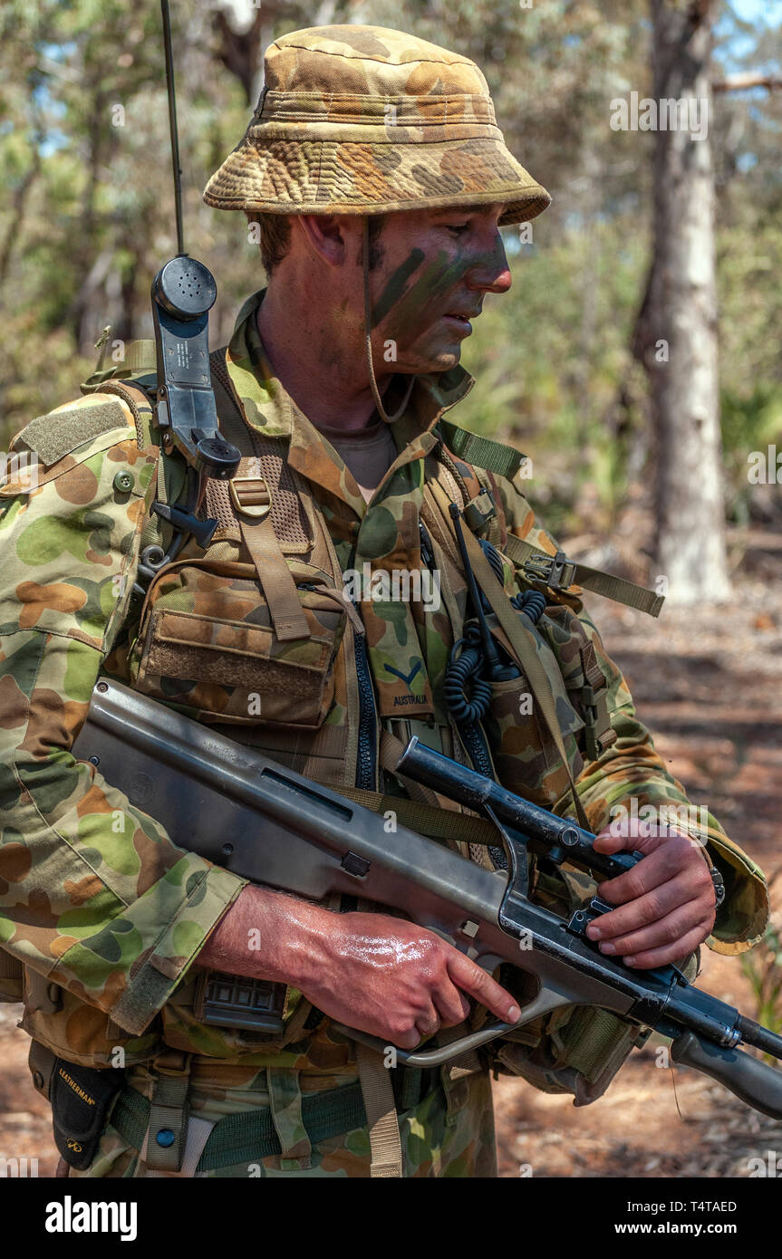 807f6345943 Australian Army reserve soldier on an exercise in the Australian bush with  a Steyer assault gun
