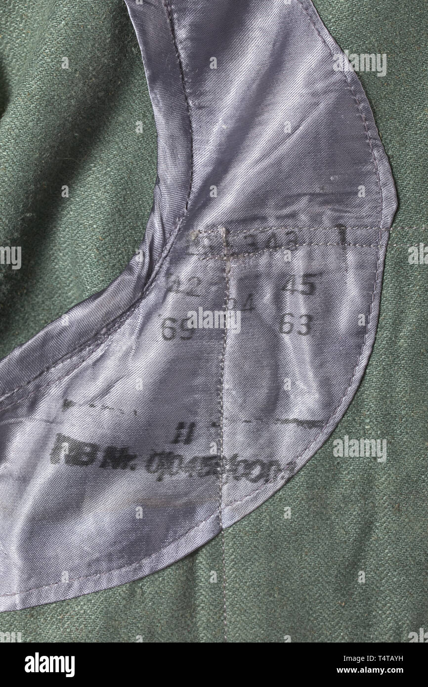 A field-grey drill cloth jacket for Luftwaffe field divisions depot piece from 1943 with Reich factory number historic, historical, Air Force, branch of service, branches of service, armed service, armed services, military, militaria, air forces, object, objects, stills, clipping, clippings, cut out, cut-out, cut-outs, 20th century, Editorial-Use-Only - Stock Image