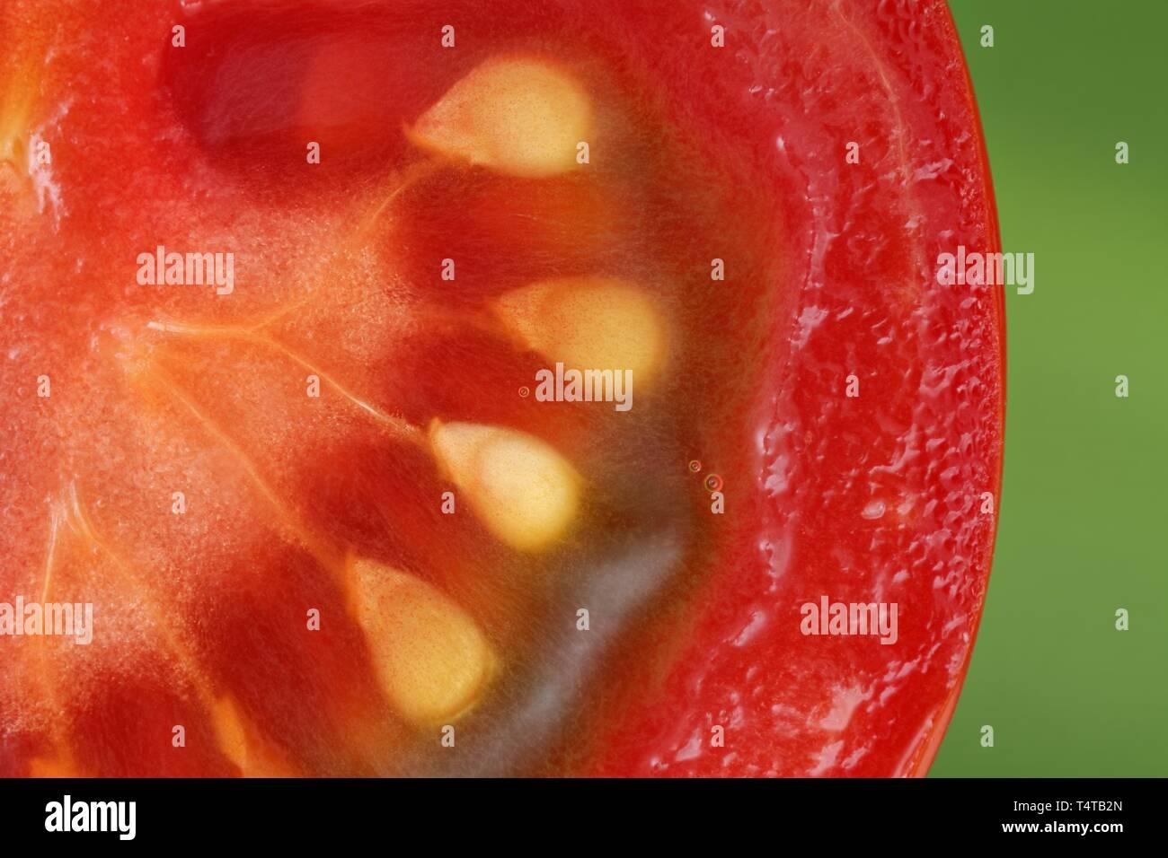 Closeup of a sliced tomato (Solanum lycopersicum) - Stock Image