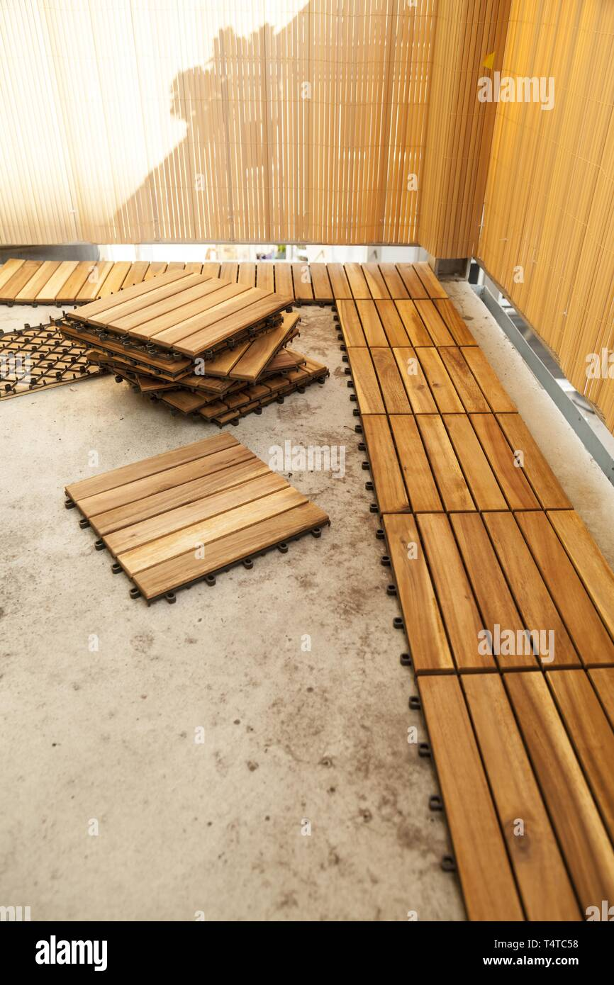 Laying Of Wooden Patio Tiles On A Balcony, Germany, Europe ...