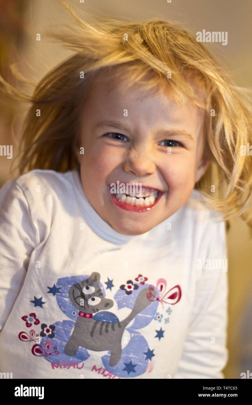 Girl, six years, grinning, Kiel, Germany Europe Stock Photo