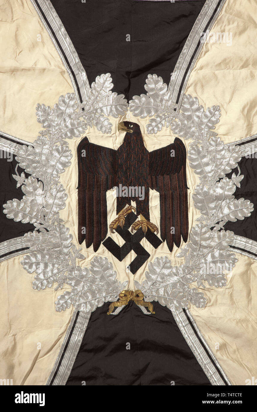 A troop flag of the infantry Made entirely of white silk with silver fringe on three sides. With a white disc on both sides, bordered by a silver-embroidered oak leaf wreath with central brown army eagle, in the background an Iron Cross of black silk, bordered in silver. The corners with black swastikas, bordered in silver. Colour-fresh, the pole-sleeve with traces of nails, barely noticeable stains. Dimensions circa 120 x 120 cm. In family possessions since the end of the war. historic, historical, infantry, military, armed forces, militaria, ob, Additional-Rights-Clearance-Info-Not-Available Stock Photo