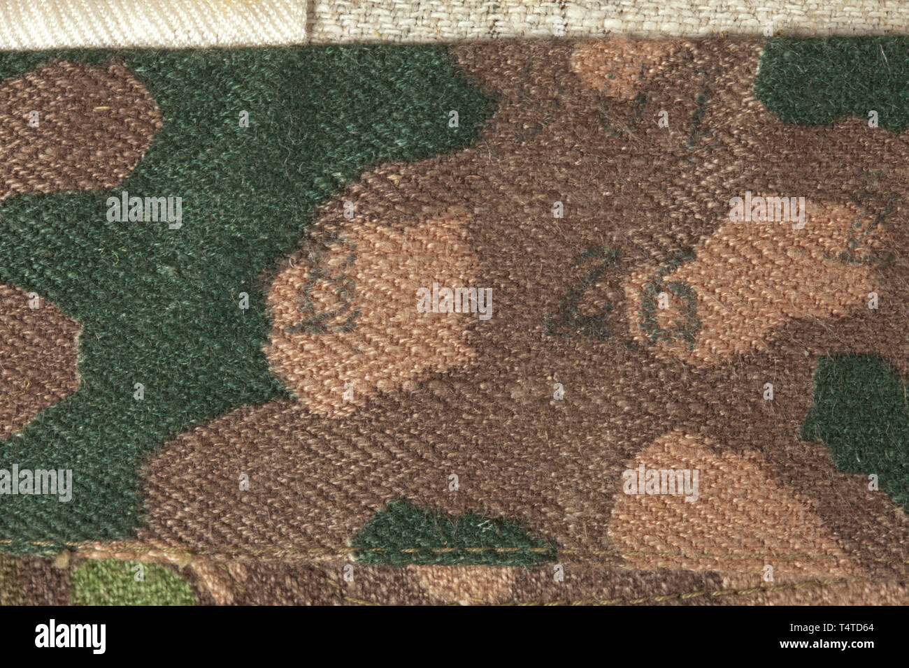 154402406047be A pair of camouflage trousers M 44 to the special clothing issue for SS  Panzer formations