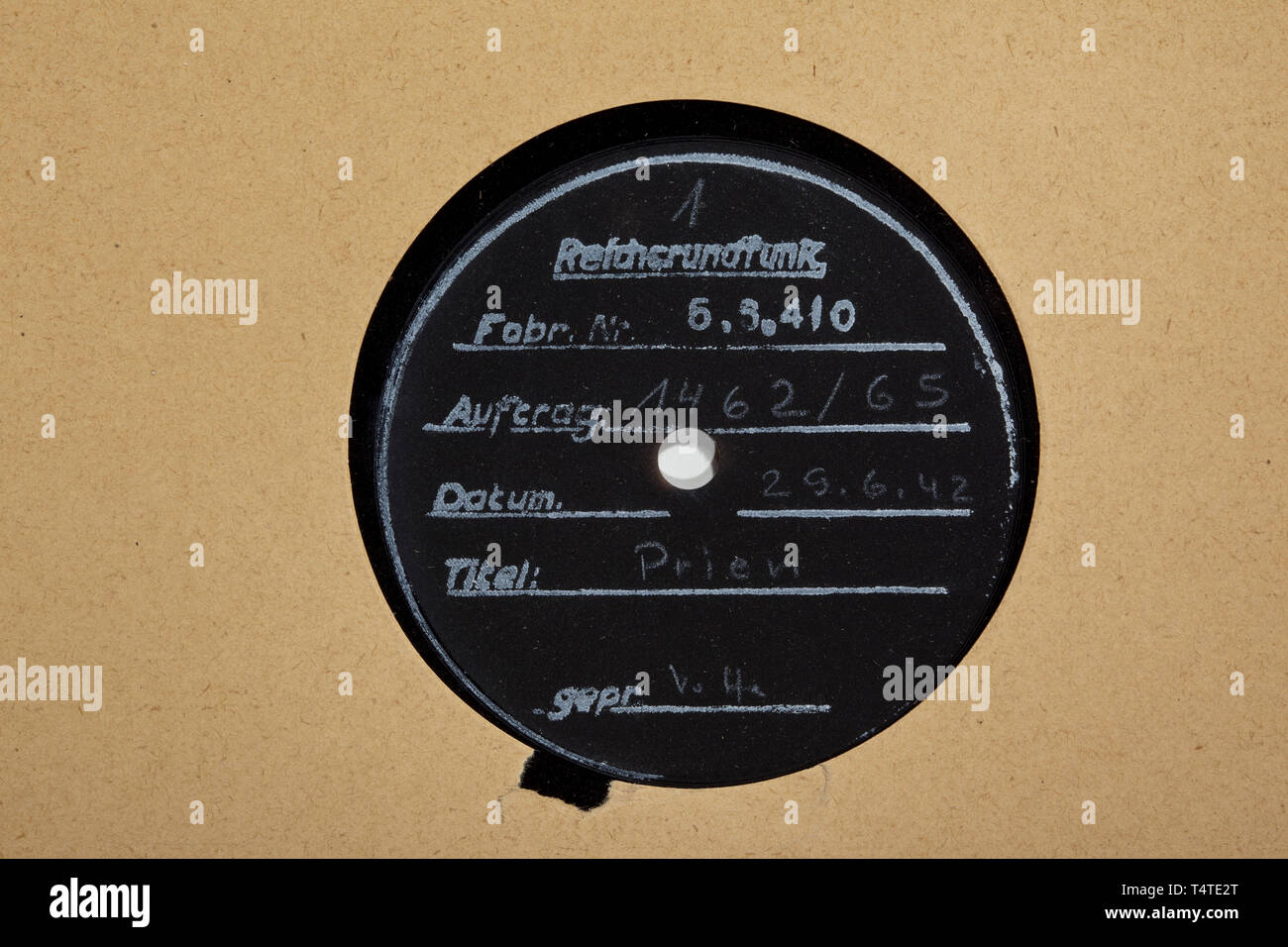Korvettenkapitän Günther Prien - seven wax records from the German Radio Broadcasting Corporation (Reichsrundfunk) with interviews after the attack on Scapa Flow in 1939, Five double-sided and two one-sided records with interviews from the years 1939/40, all labelled 'Reichsrundfunk', 'Auftr.Nr.', 'Datum' each of the year of minting 1942, with inscriptions 'Prien' or 'Kptlt. Prien'. Optically well-preserved. In slightly damaged paper covers with punched linen margin for filing. Rare audio documents, reissued in 1942 for propaganda purposes to uphold the myth of the Scapa Fl, Editorial-Use-Only - Stock Image