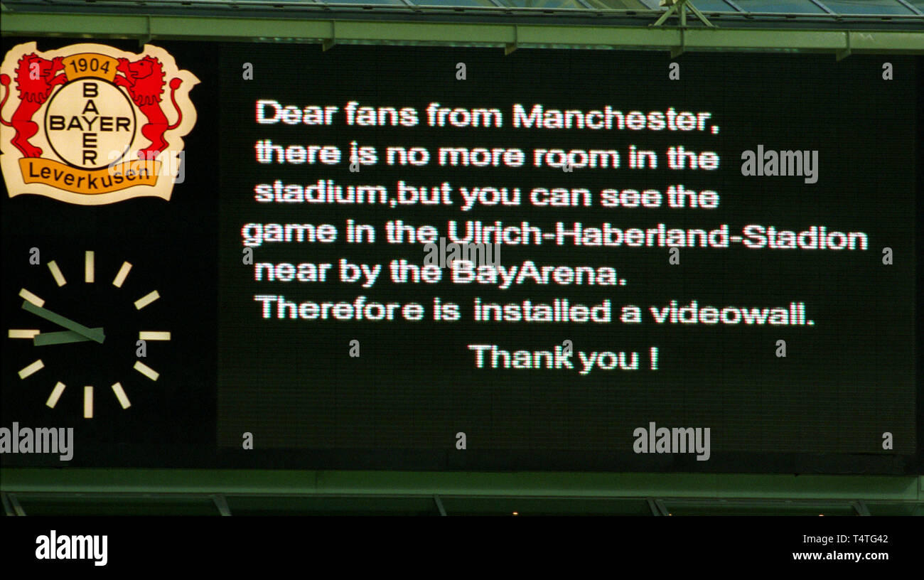 BayArena Leverkusen Germany 29.4.2002, Football: UEFA Champions League semi-final Bayer 04 Leverkusen (black/red) vs Manchester United (white) 1:1 ---- Messageboard informs Manchester fans that the stadium is full and that they can watch the match on public screens in the neighboring stadium - Stock Image