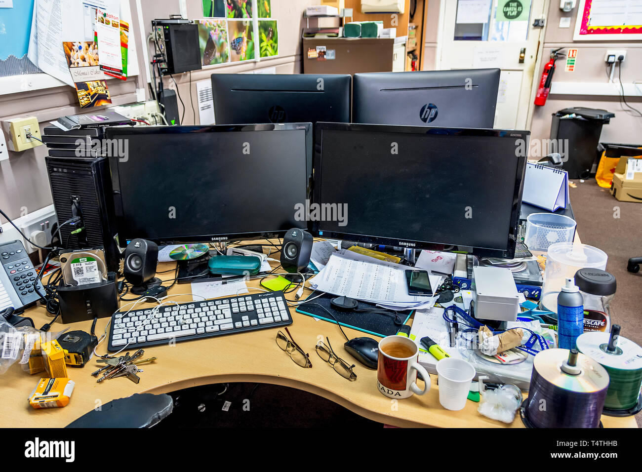 Messy desk in a workplace office. - Stock Image