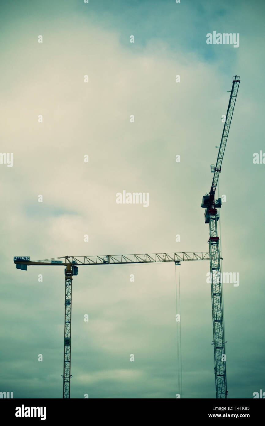tower cranes in a construction site - Stock Image