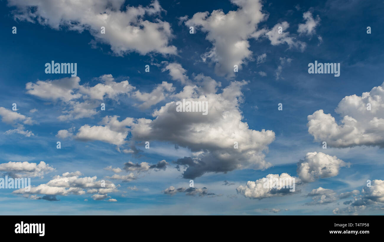 Fluffy Clouds in Blue Sky: Tuscany in Italy - Stock Image
