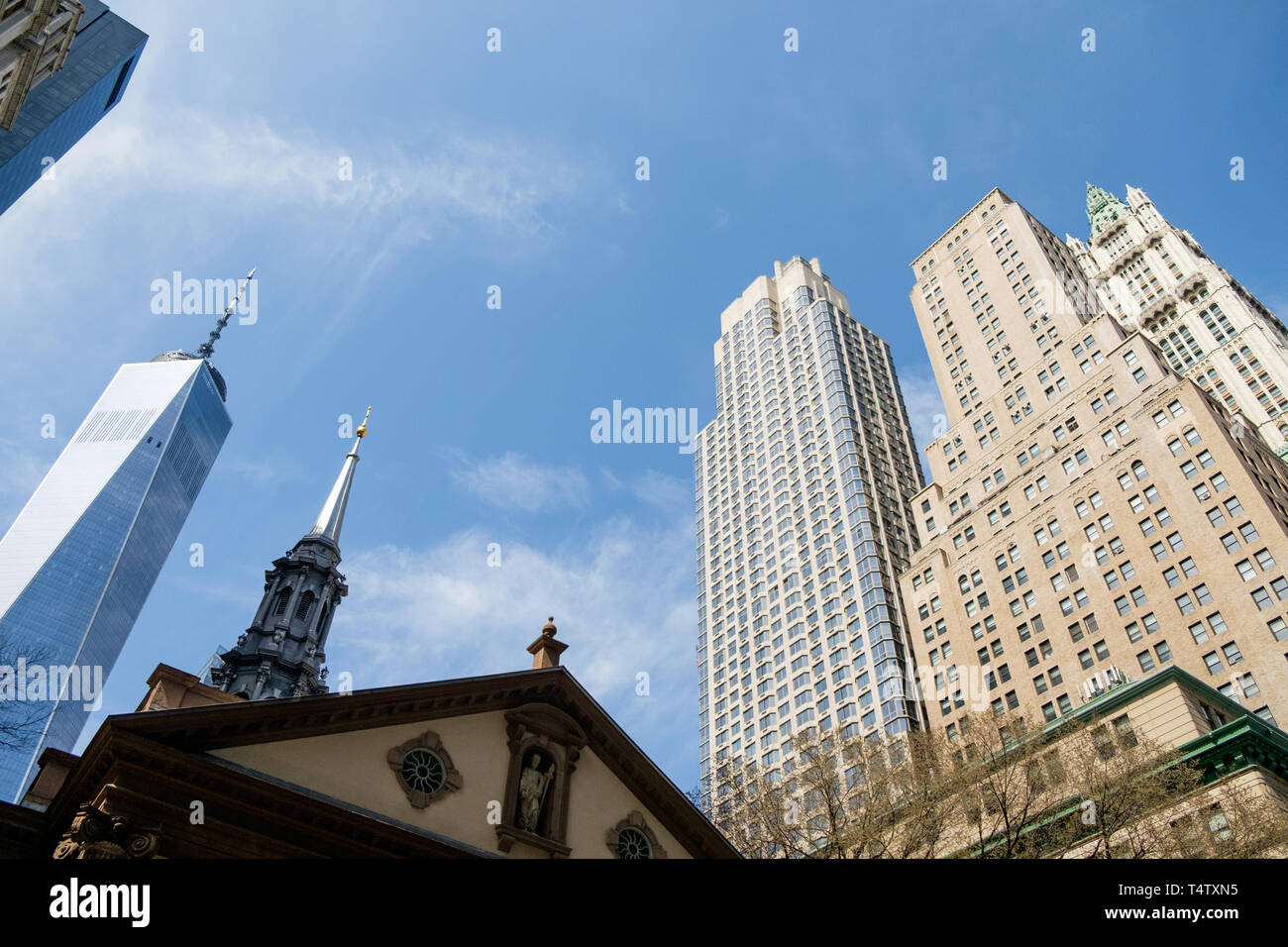 Looking up at St. Paul's Chapel Trinity Church, One World Trade, 225 Broadway and The Woolworth Building in downtown Manhattan. - Stock Image