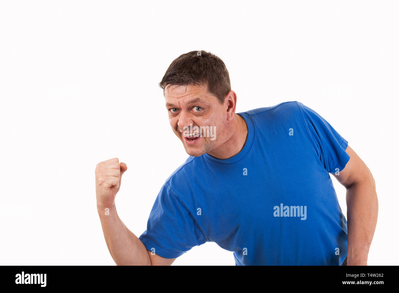 A man in victory pose-isolated - Stock Image