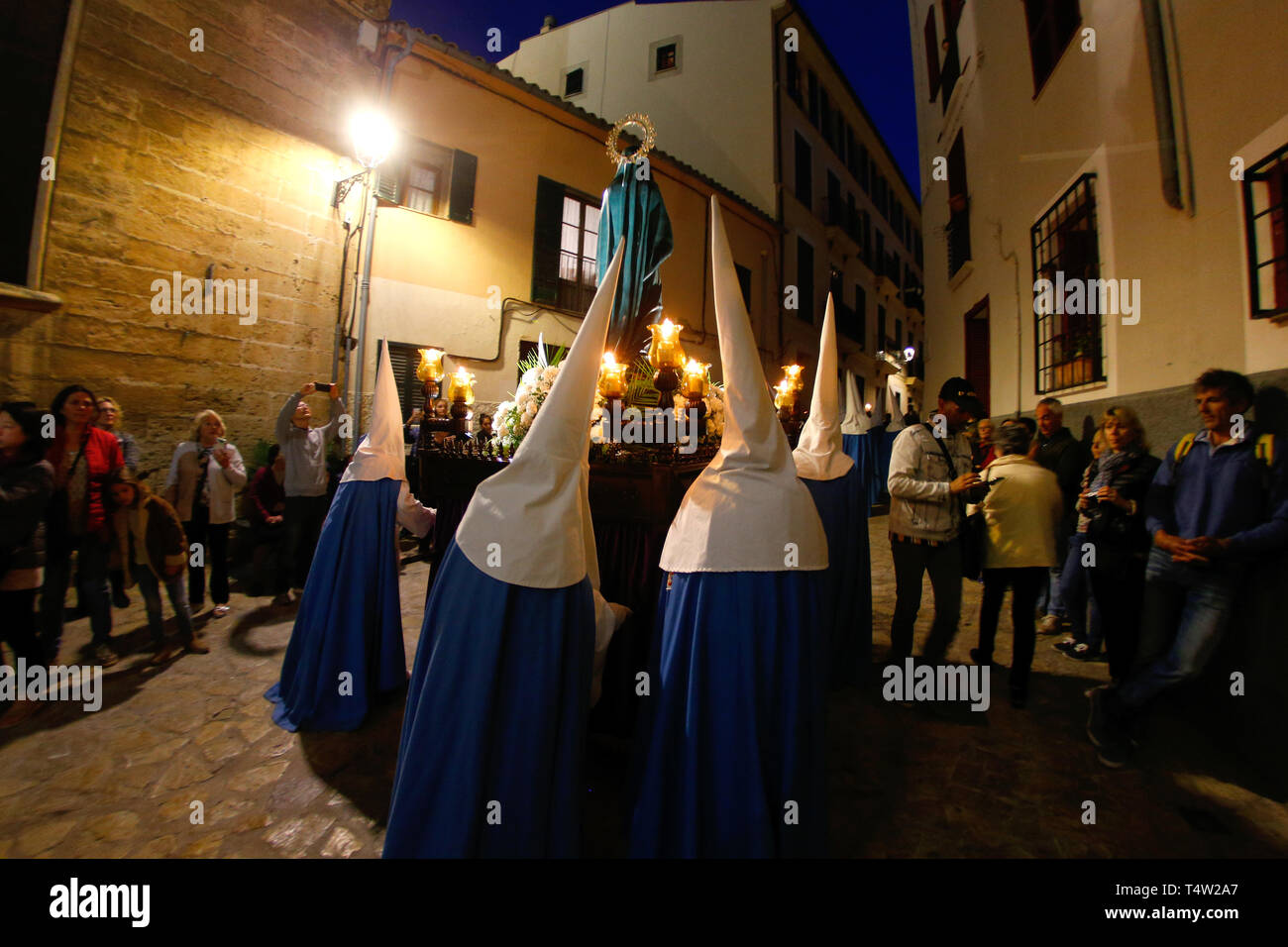 Palma de Mallorca / Spain - April 17 2019: Penitents take part in the procession of Saint christ of Santa Cruz during easter holy week in the Spanish  Stock Photo