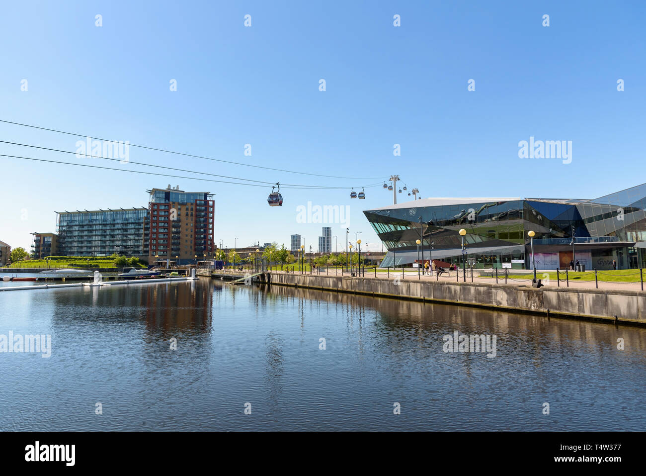 London, UK - May 1, 2018: Modern buildings and Emirates Air Line at Royal Victoria Dock in London's dockladns - Stock Image