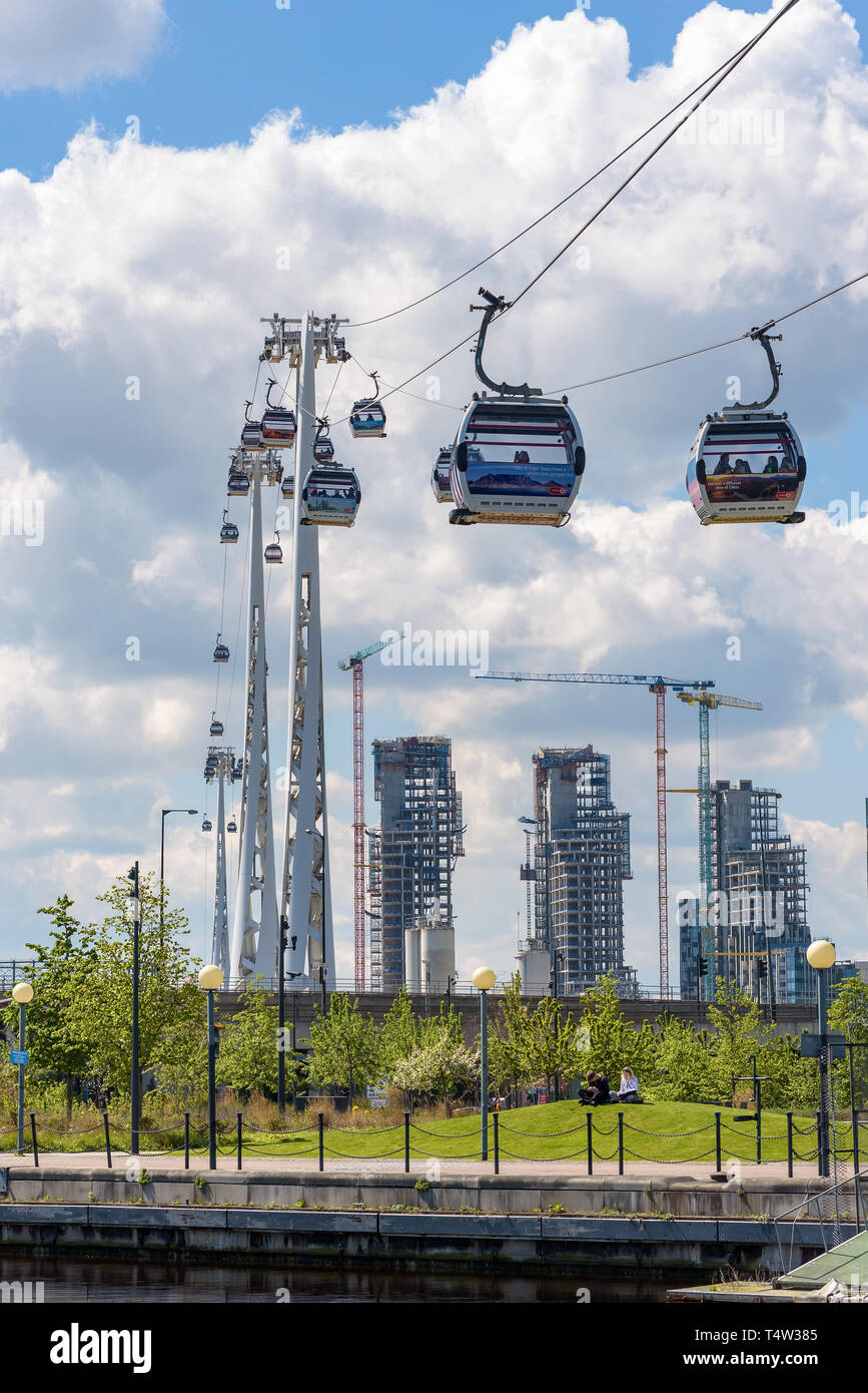 London, UK - May 1, 2018: Gondolas of Emirates Air Line depart from station at Royal Victoria Dock in eastern London - Stock Image