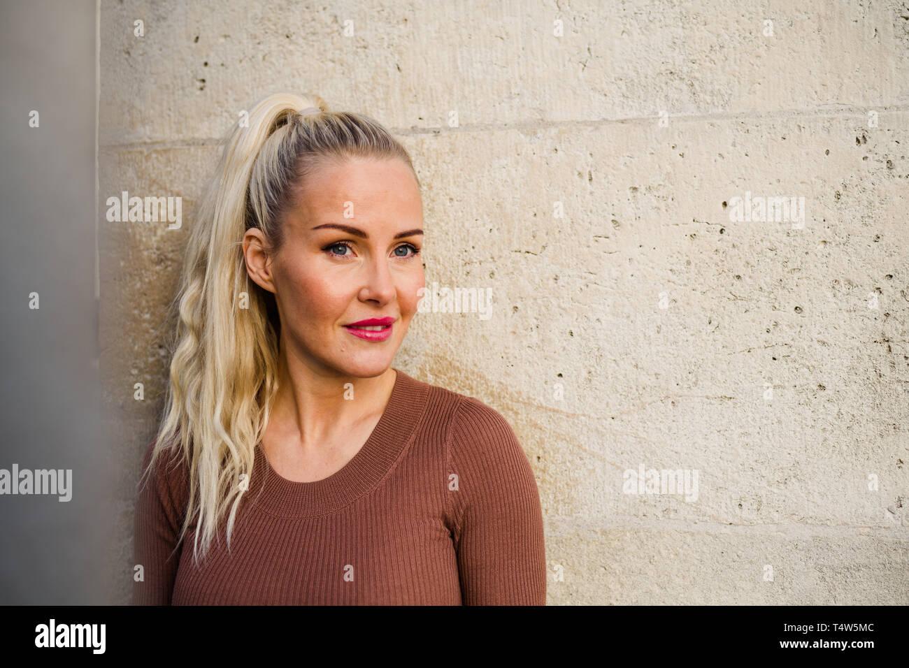 Blond woman at Fisherman's Bastion at sunrise - Stock Image