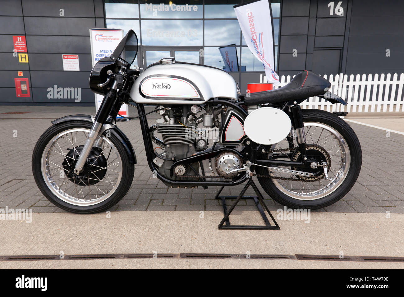 Side view of a 350cc, 1958 Norton Manx  British racing motorcycle on display at the 2019 Silverstone Classic Media Day. - Stock Image