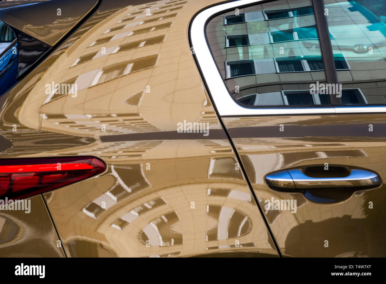A high-rise apartment block reflected in a car window in Berlin, Germany. Stock Photo