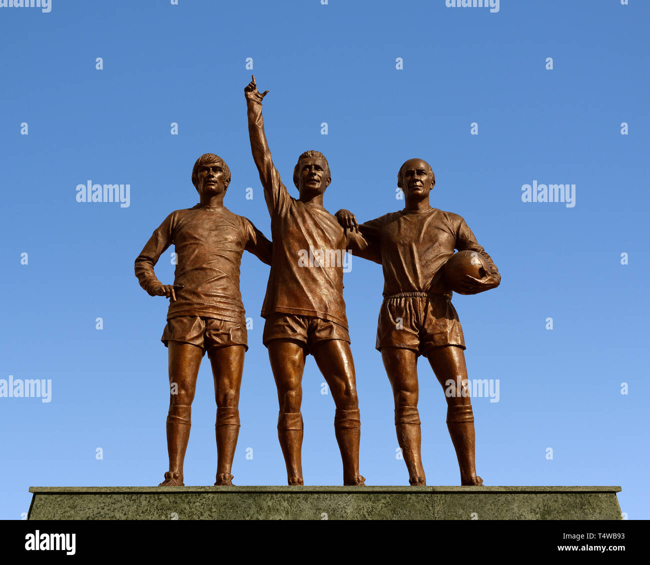 Manchester United Holy Trinity Statue Outside the Old Trafford Stadium, Manchester, England, United Kingdom - Stock Image