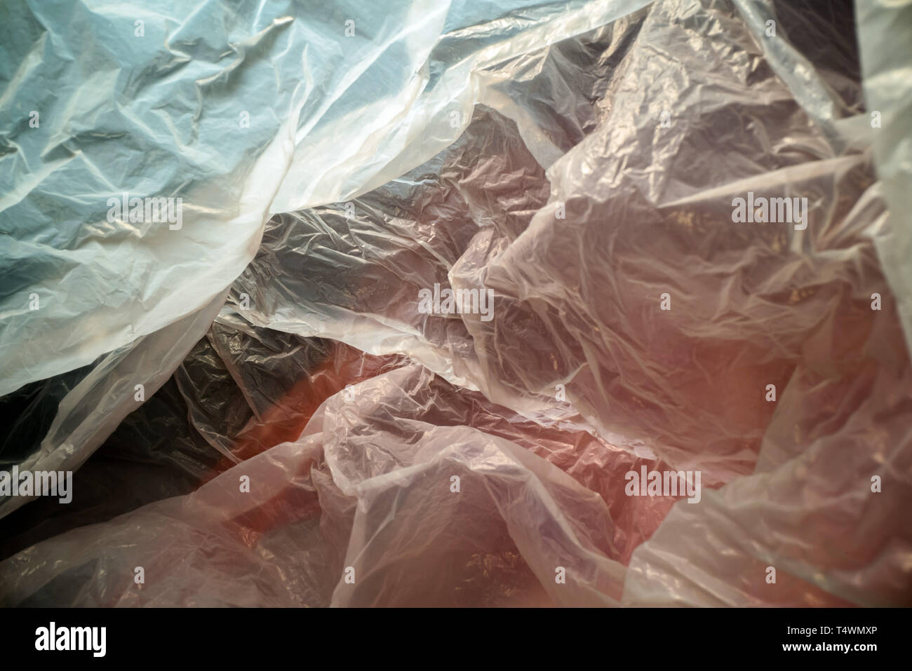 Inside a disposable plastic bag. Lightweight transparent, reusable plastic waste. Rubbish bag, plastic recycling, environmental issues - Stock Image