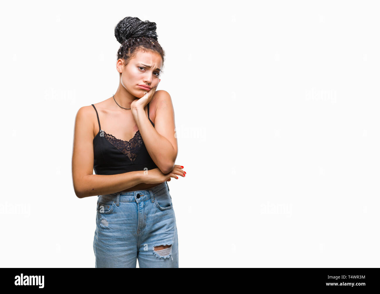 Young braided hair african american with pigmentation blemish birth mark over isolated background thinking looking tired and bored with depression pro Stock Photo