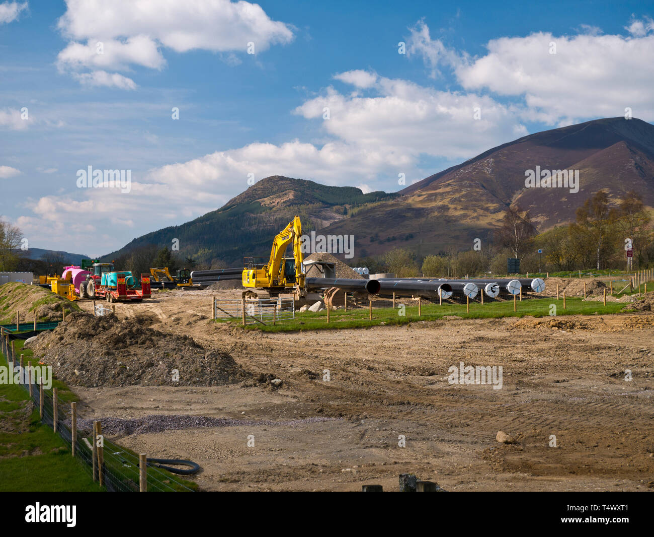Water pipes and construction equipment near Keswick servicing the West Cumbria Water Supplies project - Stock Image