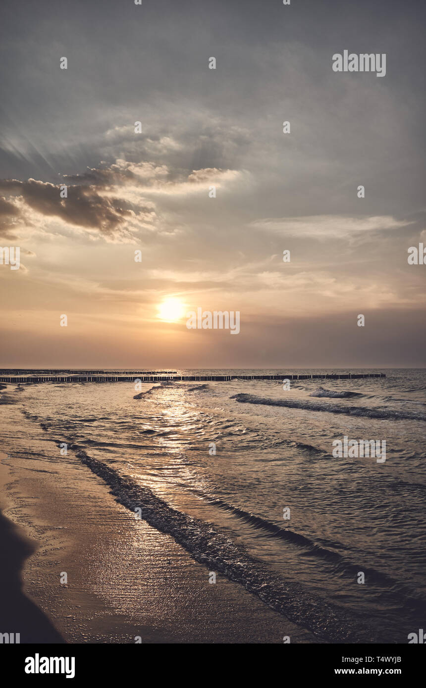 Scenic sunset over the sea, color toning applied. Stock Photo