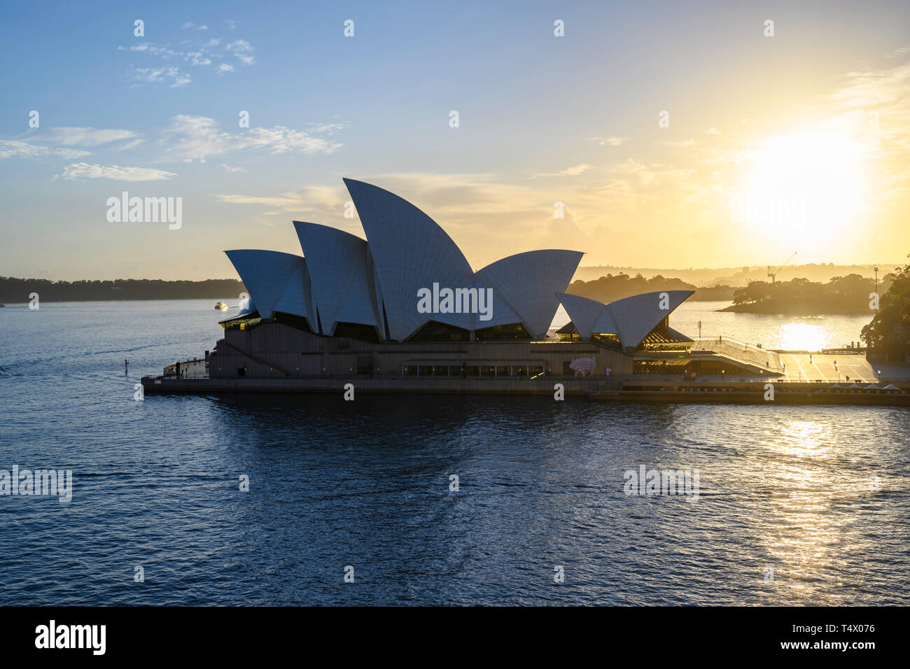 Dawn view of Sydney Opera House, a performing arts centre at Sydney harbour, New South Wales, Australia.  Designed by Jørn Utzon, it opened in 1973. Stock Photo