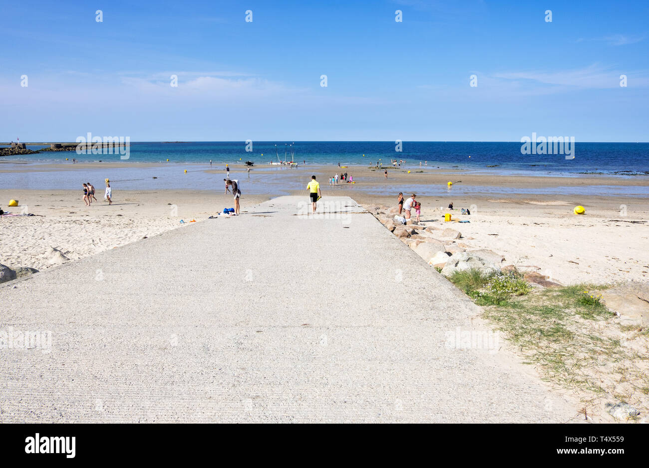 Cherbourg-Octeville, France - August 28, 2018: Children and adults on the beach in Cherbourg. Normandy, France - Stock Image