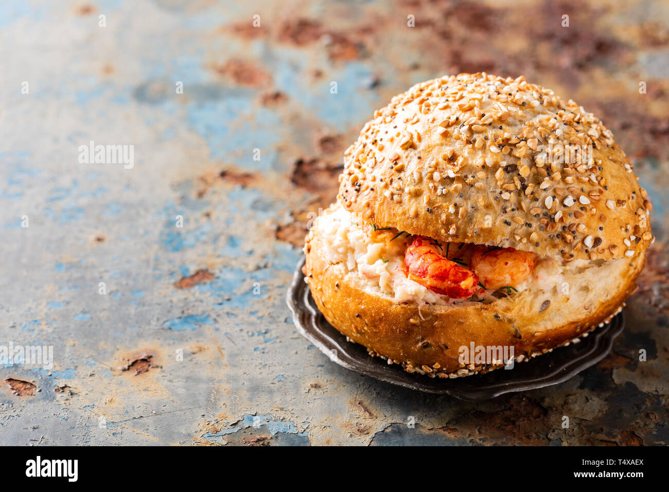 Sandwiche with crab salad and shrimp on old wooden table. Healthy food background concept with copy space - Stock Image
