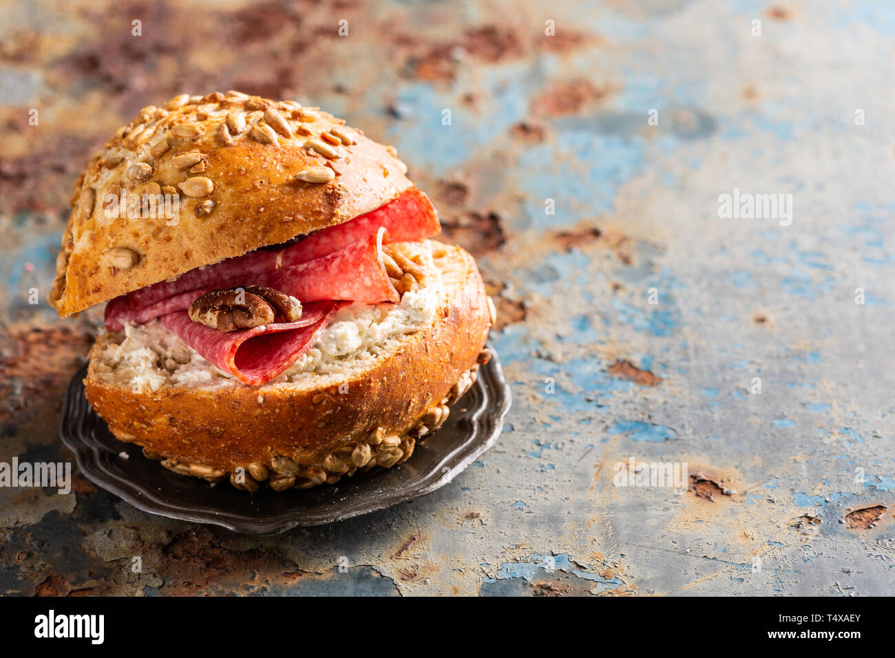 Sandwiche with salami and walnut, multigrain bun. Healthy lunch concept with copy space - Stock Image