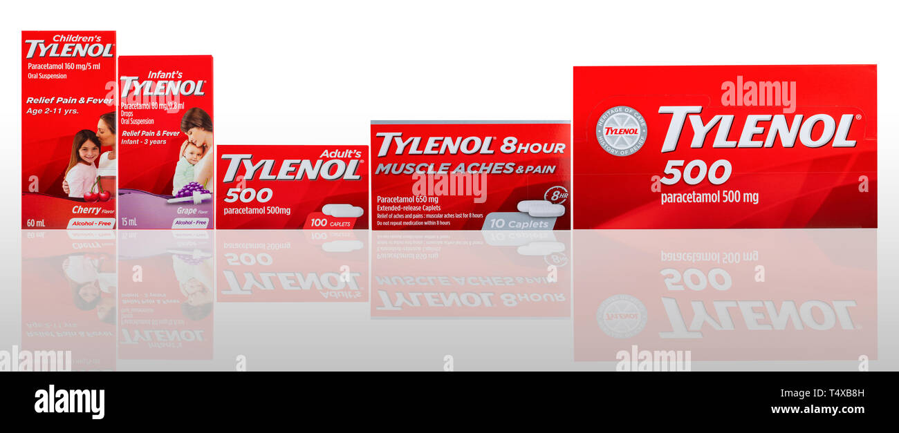 CHONBURI, THAILAND-OCTOBER 27, 2018 : Tylenol caplets and oral suspension in red packaging on gradient background. Drug for relief pain, fever, muscle - Stock Image