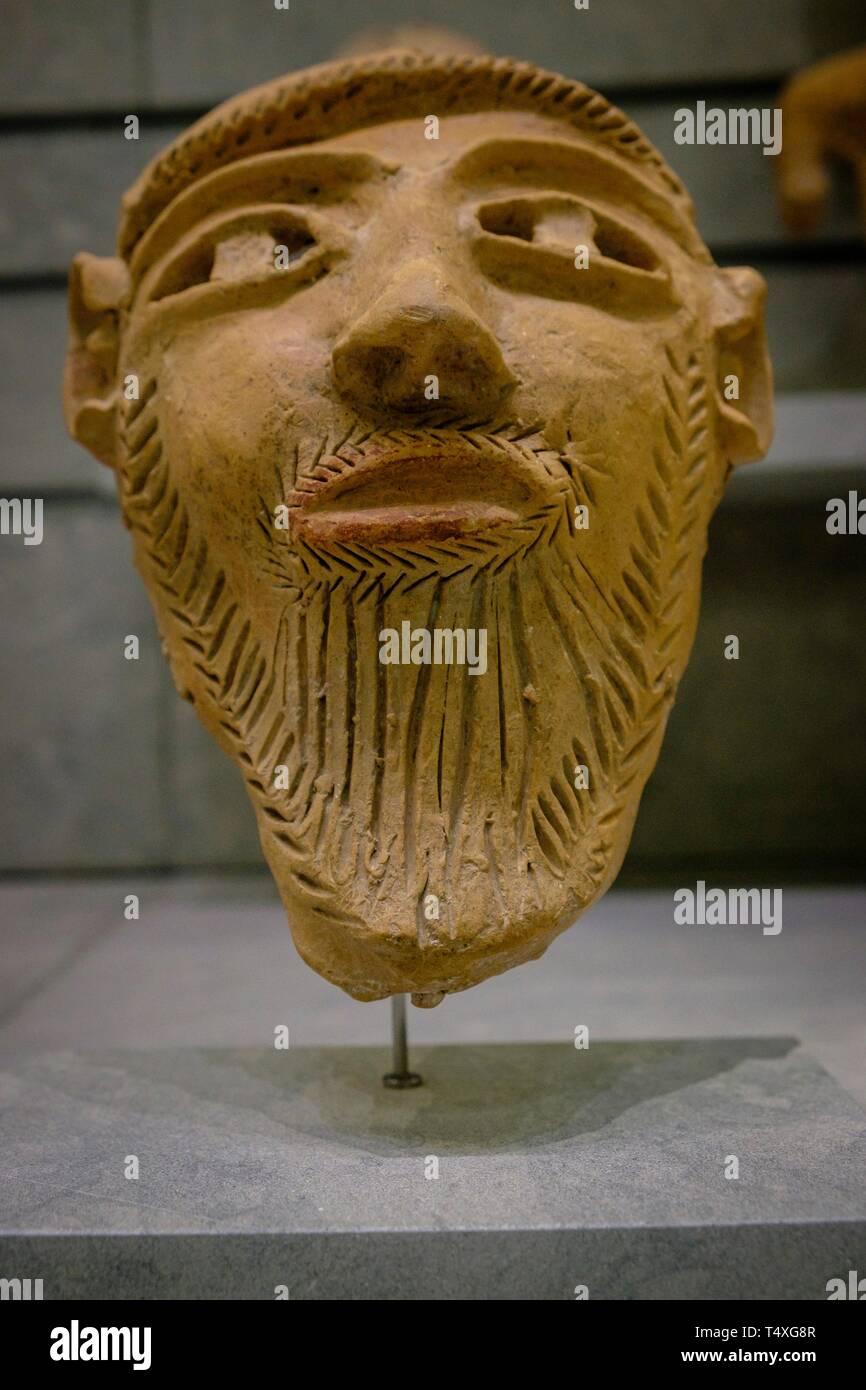 mascara funeraria barbada, estilo púnico-ebusitano, 400-300 a.C, Museo arqueológico de Ibiza y Formentera, Patrimonio de la Humanidad «Ibiza, biodiversidad y cultura», Ibiza, balearic islands, Spain. - Stock Image