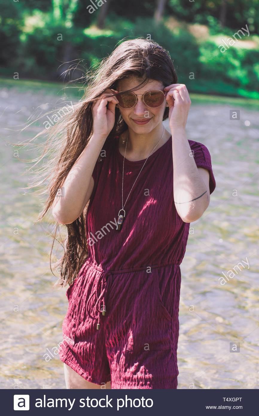 wears purple romper - Stock Image